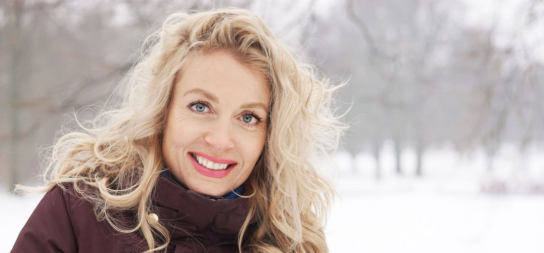 Portrait of smiling mature woman during winter