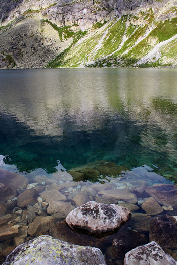 Dolina Hińczowa Green Hińczowe Stawy Reflection Rock Tatra Mountains Tatry The Week On EyeEm Beauty In Nature Clear Water High Mountain Lake Lake Landscape Mountain Mountain Lake Mountain Range Nature Rock - Object Rocks And Water Scenics Slope Tranquil Scene Tranquility Turquoise Water Summer Exploratorium