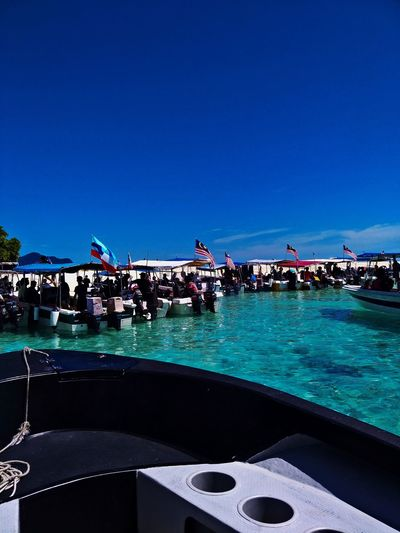 Sibuan island Sea And Sky Sea Outdoor Activity Beauty In Nature Beutiful  Tourism Diving Sea Boat Nature Sibuan Island, Water Sky Clear Sky Copy Space Nature Sea Blue Large Group Of People Group Of People Day Land Real People Crowd Enjoyment Outdoors Sport