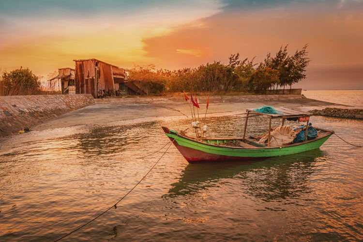 A lonely boat in the red sunset Alone Architecture Can Gio, Ho Chi Minh City City Cityscape Day Lonely Lonely Boat No People Outdoors Red Dusk Red Sunset Seascape Photography Sky Stunning Sunset Sunset Tourism Travel Travel Destinations Tree Vacations Vietnamese Landscape, Water
