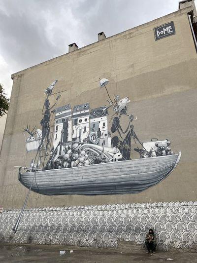 Men in boat against sky