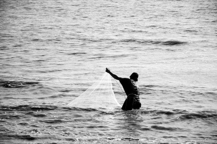 Leisure Activity Fishing Net Sea People Black And White Outdoors Casual Clothing Non-urban Scene People Photography Non Urban Scene Person Street Photography Streetphotography People And Places