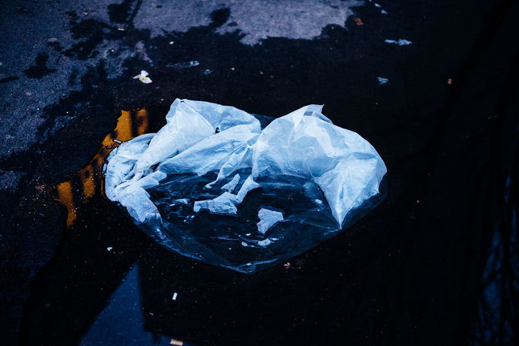 Everything End Plastic Pollution EyeEm Best Shots Bag Blue Close-up Cold Temperature Crystal Day Environment Garbage Geology High Angle View Mineral Nature No People Outdoors Plastic Bag Reflection Rock Social Issues Solid Still Life