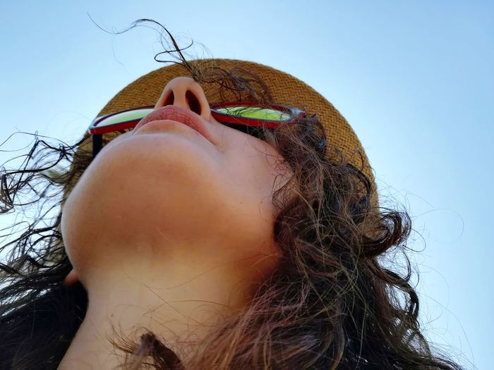Woman's face photographed from below Woman With Hat Woman Searches The Horizon Tourist Woman's Face Close Up Woman's Face Woman Chin Of A Woman Chin Long Neck  Woman Photographed From Below Personal Perspective Young Women Headshot Sky Close-up