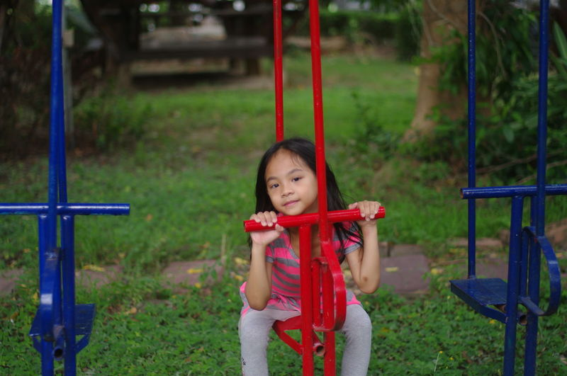 Portrait of girl playing on playground