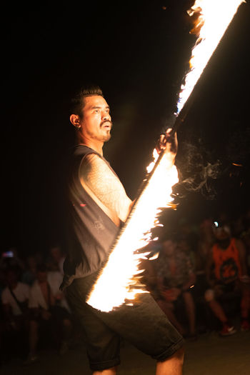 Fire performance Night Side View Illuminated Burning Motion Real People Fire Three Quarter Length Heat - Temperature Flame Performance Firework Display Burning Burn Spinning Spinner Twirling Spin Flaming Torch Crowd Dangerous Fire - Natural Phenomenon Performing Arts Event Performer
