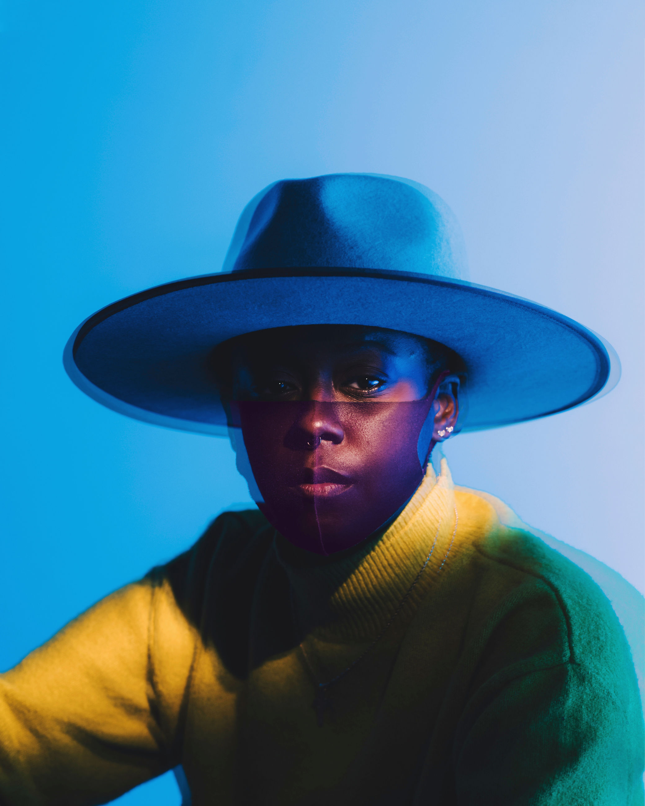 blue, portrait, one person, hat, clothing, adult, headshot, studio shot, front view, blue background, colored background, young adult, person, men, fashion accessory, looking at camera, fashion, human face, fedora, indoors, looking, sun hat, serious, casual clothing