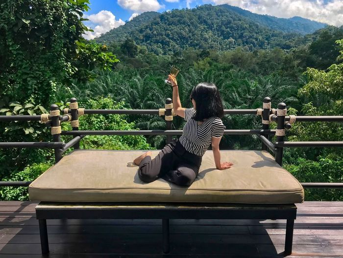 Relaxing time with nature Celebration Barcony Tent View Traveling Travel Photography Hill Wine Forest Hotel Resort One Person Real People Plant Tree Leisure Activity Full Length Nature Lifestyles Women Mountain Sunlight Growth Green Color Railing Human Arm Sitting Outdoors Beauty In Nature Day EyeEmNewHere
