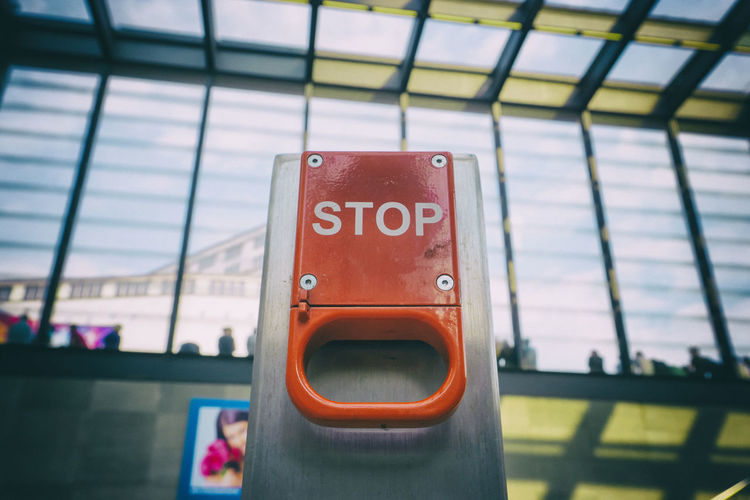 Close-up of stop text on emergency brake at berlin potsdamer platz