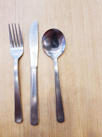 stainless steel Spoon And Fork Still Life High Angle View Indoors  Directly Above Close-up No People Table Day