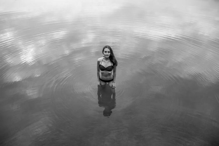 High Angle Portrait Of Young Woman Wearing Bikini Standing In Lake
