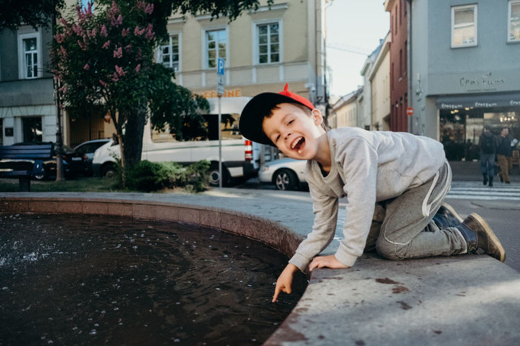 Architecture Boys Building Exterior Built Structure Car Casual Clothing Child Childhood City Innocence Leisure Activity Looking At Camera Males  Men Motor Vehicle One Person Outdoors Portrait Real People Street Transportation