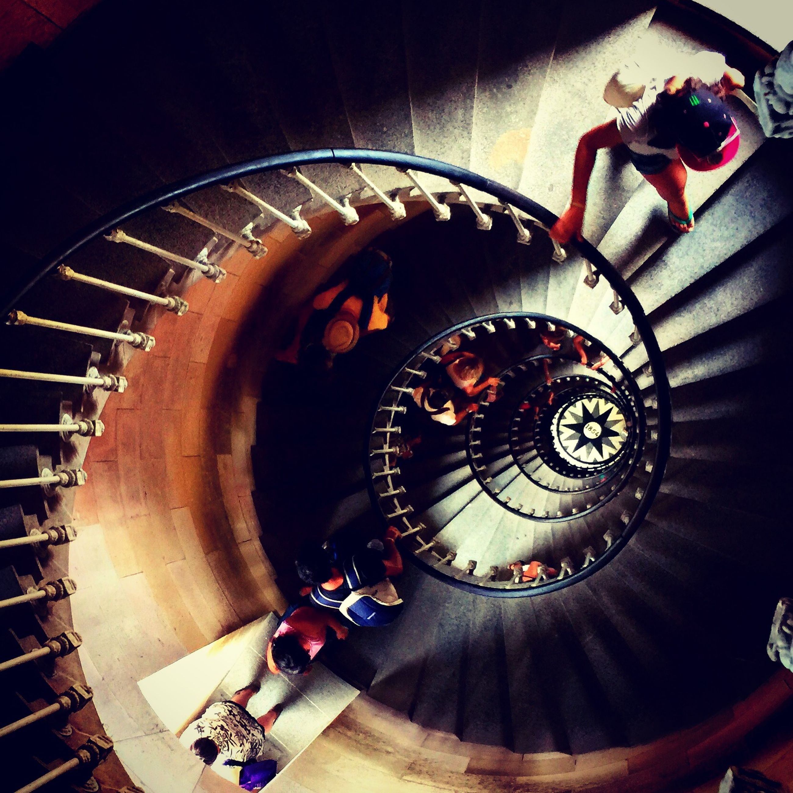 indoors, steps and staircases, staircase, technology, steps, spiral staircase, spiral, high angle view, circle, railing, illuminated, arts culture and entertainment, machine part, machinery, metal, built structure, close-up, music, low angle view, photography themes