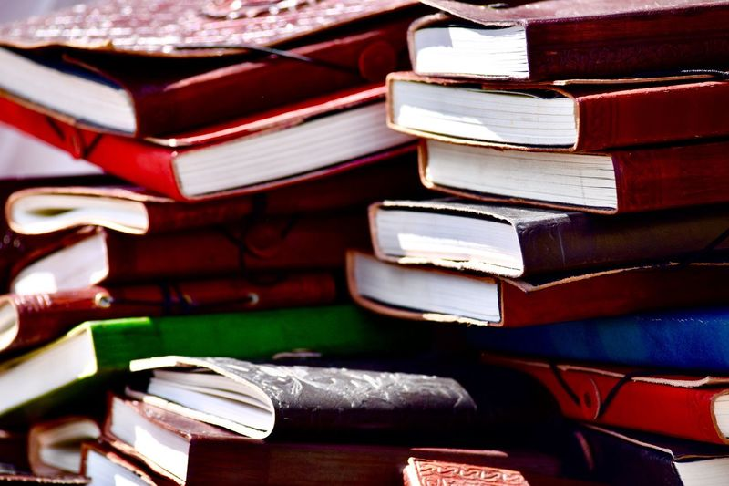 Knowledge Wisdom Nostalgic  Old Books Stack Publication Book Education Indoors  Still Life Close-up Large Group Of Objects Table Learning No People Focus On Foreground Full Frame Wisdom Backgrounds Hardcover Book Group Of Objects Arrangement Expertise Old