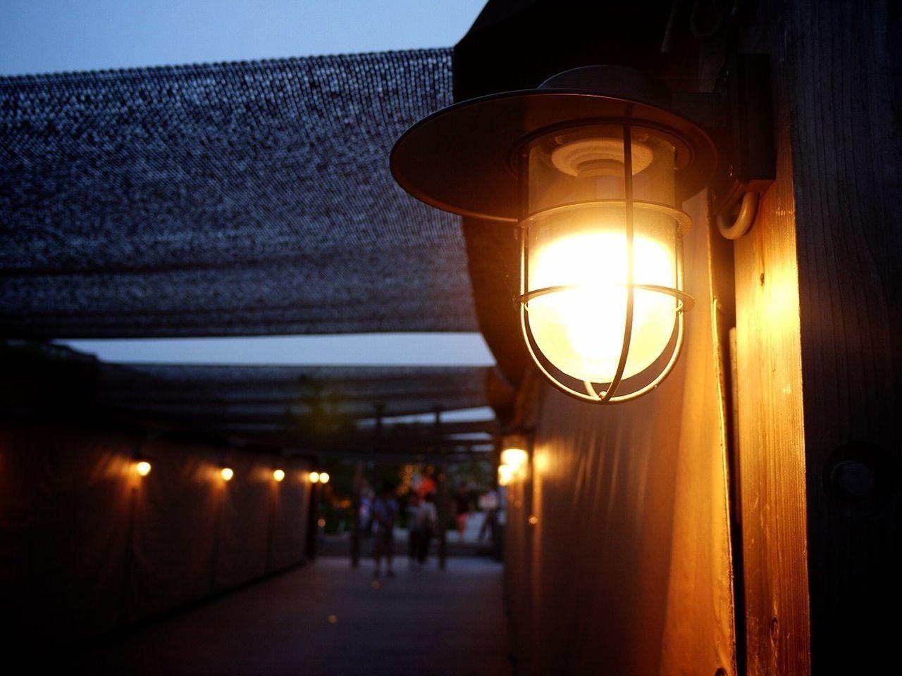 Close-up of illuminated electric lamp outdoors