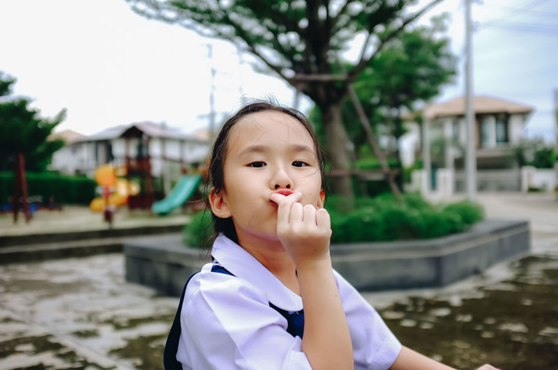 Portrait of cute girl gesturing in playground