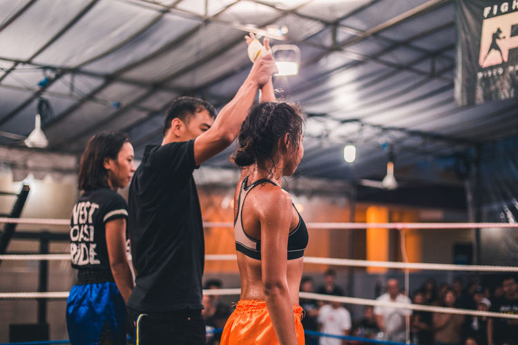 Someone had to win. International Women's Day 2019 Women Real People Lifestyles Sport Togetherness People Exercising Healthy Lifestyle Leisure Activity Young Adult Young Women Vitality Sports Clothing Hairstyle Arms Raised Winner Victory Sportswoman Muay Thai