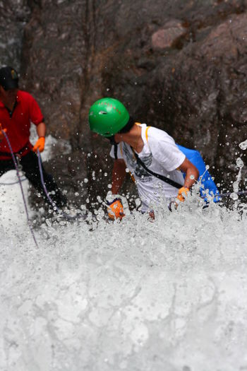 Adult Adults Only Adventure Challenge Day Extreme Sports Full Length Headwear Helmet Leisure Activity Motion Only Men Outdoors People RISK Skill  Sport Sports Helmet Sprinkle Young Adult