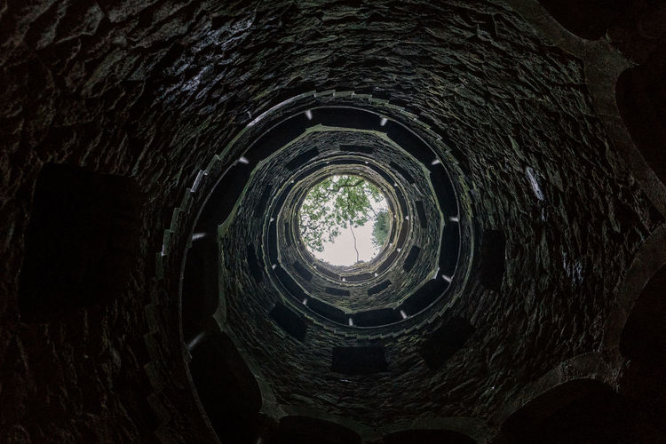 Quinta Da Regaleira Sintra (Portugal) Sintra, Portugal Sintra Architecture Built Structure No People History The Past Indoors  Well  Old Wall Stone Material Geometric Shape Wall - Building Feature Tunnel Pattern Low Angle View Stone Wall Brick Light At The End Of The Tunnel Ancient Civilization Spiral Staircase