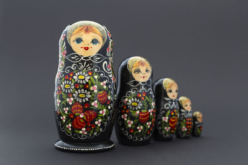 Beautiful painted black white and red russian nested dolls (matryoshka) on black background Doll Russia Tradition Art Babushka Black Background Close-up Craft Culture Design Girl Handmade Matreshka Matryoshka Nested Nested Doll No People Object Ornate Russian Souvenir Studio Shot Toy Traditional Wooden