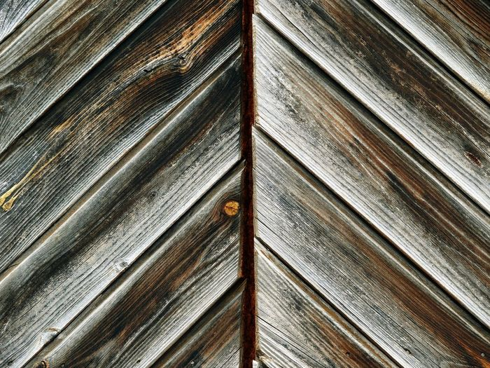 Pattern Wood - Material Backgrounds Textured  Striped Full Frame Close-up Wood Grain Abstract Rusty Wood Paneling Brown No People Hardwood Built Structure Symmetry Rotting Day Architecture Outdoors Corrugated Iron Nature My Best Photo