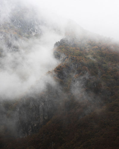 High angle view of mountains during foggy weather