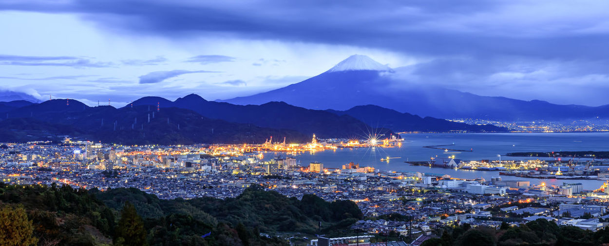 High angle view of city by sea and fuji mountain backgrounds