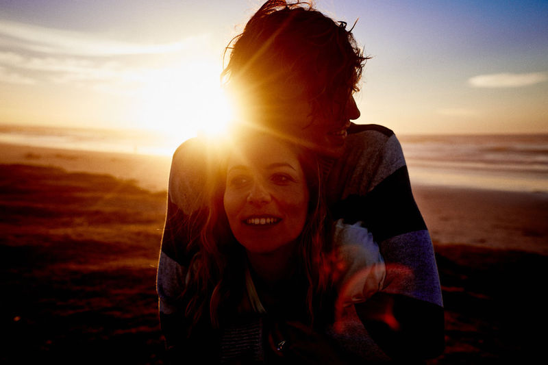 Beach Beauty In Nature Bonding Fun Happiness Horizon Over Water Leisure Activity Looking At Camera Love Nature Outdoors Real People Sand Sea Sky Smiling Sun Sunlight Sunset Togetherness Two People Vacations Water Young Adult Young Women