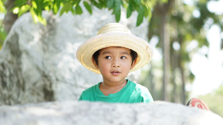 Portrait of cute boy wearing hat