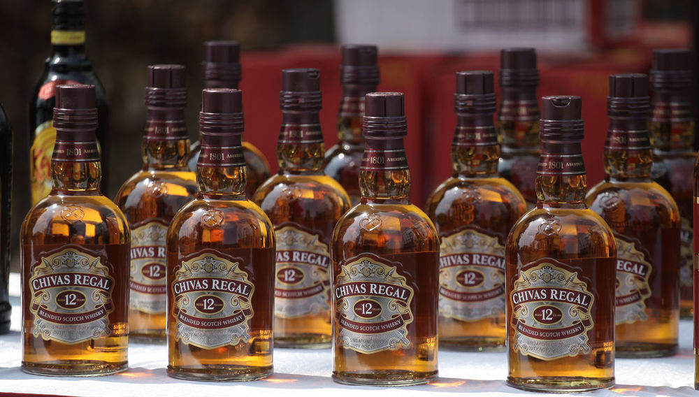 Liquor Evidence Scotch Whisky Alcohol Alternative Medicine Bottle Chivas Chivasregal Close-up Day Drink Evidence Of A Climate Change Focus On Foreground Herbal Medicine Indoors  Label Large Group Of Objects Liqueur No People Whiskey