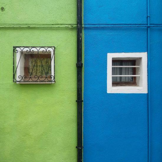 Close-up of window on green door