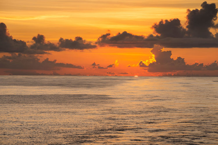 When the setting sun kiss the horizon 03 Sunset Sky Beauty In Nature Orange Color Tranquility Sea Water Horizon Over Water Horizon Nature Romantic Sky Cloud Dusk Sink