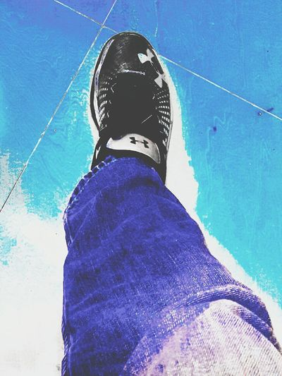 Stepforward Stepping Out Walking Going The Distance One Person One Man Only Adult Shoe Jeans Jeans And Sneakers Blue Color Blue Jeans UnderArmour Underarmour!!!!!