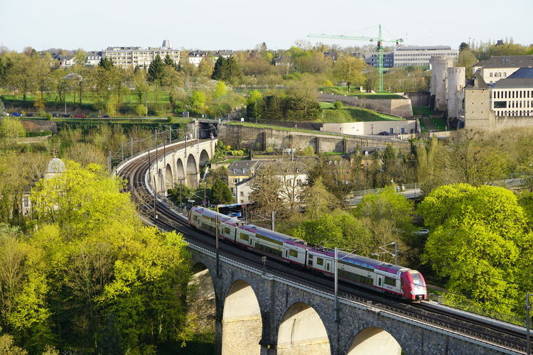railing Luxembourg Railroad Track Arch Arch Bridge Architecture Bridge Bridge - Man Made Structure Building Exterior Built Structure Car City Connection Day Land Vehicle Mode Of Transportation Motor Vehicle Nature No People Outdoors Plant Rail Transportation Road Transportation Tree Water