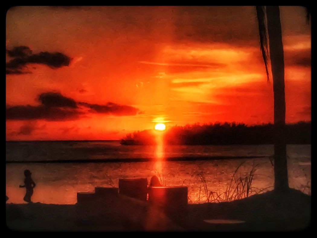 Sunset Orange Color Sky Nature Cloud - Sky Reflection Water Beauty In Nature Scenics Tranquility Tranquil Scene Silhouette No People Outdoors Sea Day Hurricane Irma 2017 Recovery Recovering Jogging Florida Keys Horizon Over Water Vacations Silhouette Sun Person joggig on Florida Keys beach at sunset.