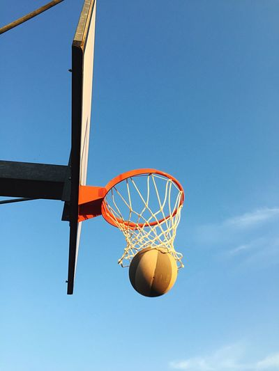 Playing basketball against sky Basketball - Sport Basketball Hoop Sport Making A Basket Low Angle View Basketball Net - Sports Equipment Blue Day Ball Sky Court Outdoors Basketball Player No People Basketball Leisure Games Basket Winner Sports Game Win Close-up Competition Freedom 10