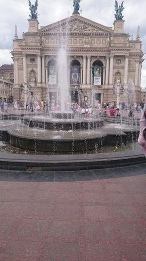 Adult Architecture Building Exterior Built Structure City Day Fountain History Large Group Of People Lviv Lviv Opera Monument Outdoors People Sky Statue Tourism Travel Travel Destinations Vacations Water