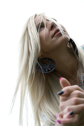 Low Angle View Of Young Woman With Blond Hair Looking Away