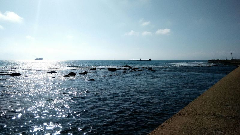 Beautiful Sea Reflections In The Water Blue Sky And Clouds Neautuful Summer Day at Livorno, Italia/ Leghorn, Italy