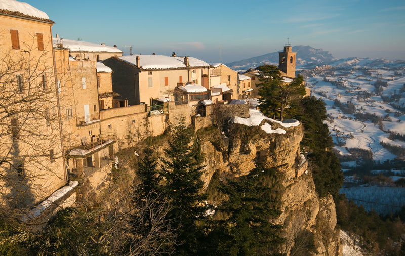 Panoramic view of Montefalcone Appennino village in the Marche region Amazing View Rock Winter Architecture Building Exterior Built Structure City Cityscape Dusk High Angle View History Italy Marche Medieval Montefalcone Appennino Mountain Nature Residential District Sky Snow TOWNSCAPE Travel Destinations Tree Village Winter Wonderland