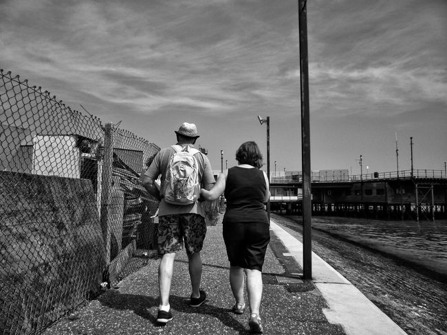 Following onto Southend pier. The Following Following Arm In Arm Black And White Black & White