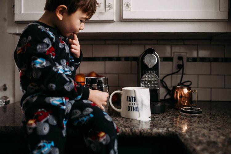 Boy holding ice cream at home