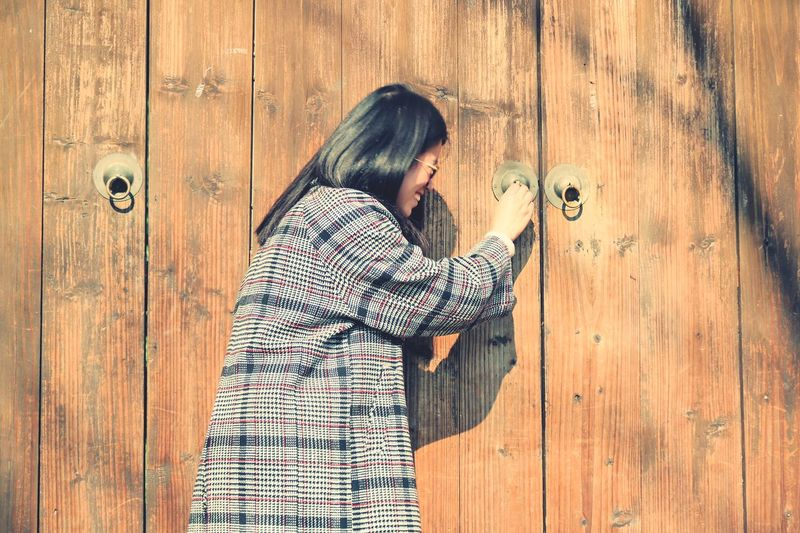 Knock knock EyeEm Selects Wood - Material Door Love Standing Togetherness Women Warm Clothing Day Outdoors People