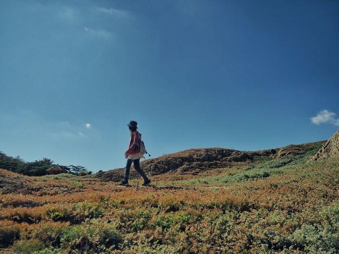 Walking under the blue sky