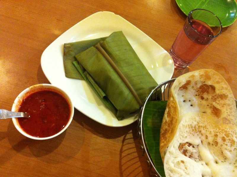 Peel the layers to find the treasure Appam Church Cuisine Fish Steamed In Banana Leaf Food Food And Drink Freshness KarimeenPollichathu Kerala Cuis Pancake Like App Spices Table
