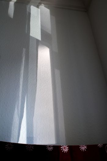 Sunlight falling on white wall