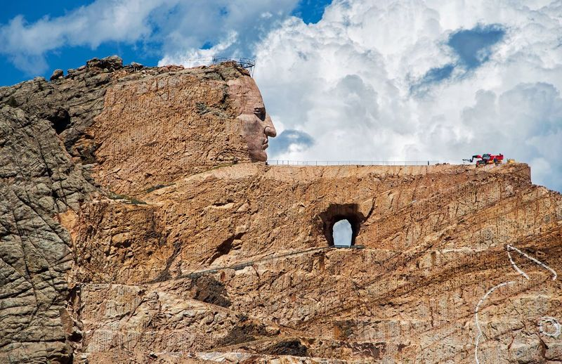 Roadtrip USA America Summer Travel Landmark Handmade Clouds Indian South Dakota Custer Rock Object Memorial Crazy Horse Crazy Horse Memorial Cloud - Sky Sky Low Angle View Domestic Animals Rock - Object Built Structure Architecture Mountain Day Mammal Outdoors