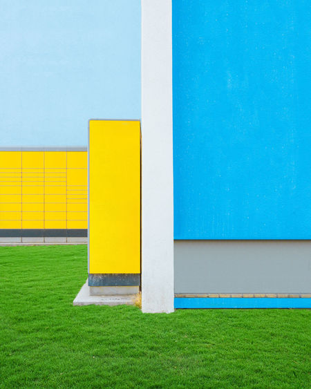 Yellow Grass Built Structure Architecture Wall - Building Feature Blue Day Green Color No People Copy Space Plant Building Exterior Outdoors Building Multi Colored Nature Absence White Color Field Single Line Blank