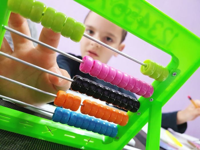 Boy Counting Colorful Abacus
