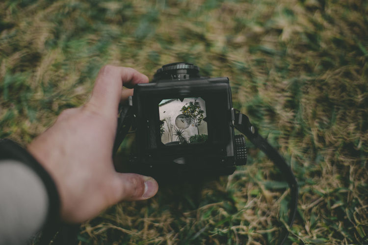 Person photographing through camera